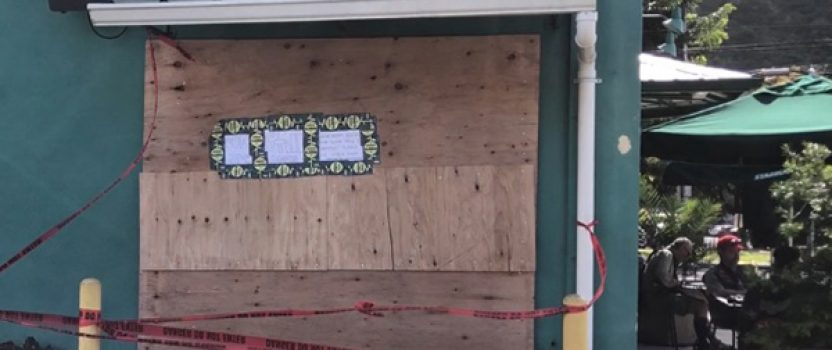 Strong winds cause store front glass to break and shatter