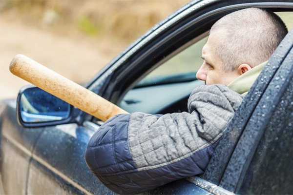 Road rage suspect takes baseball bat to other driver's windshield